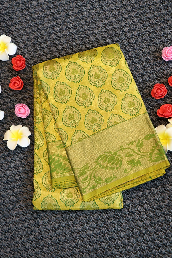 Lemon colour kanchipuram silk saree with self colour border and pallu