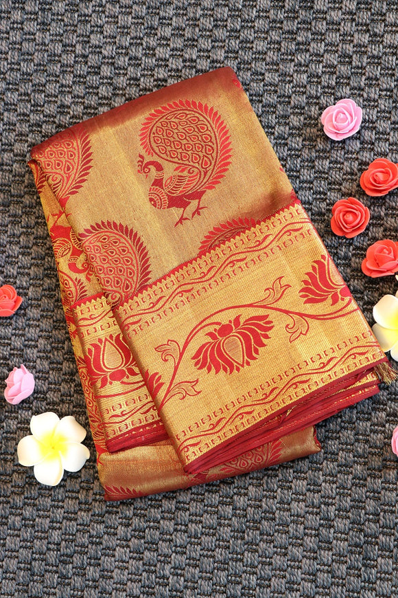 Bright maroon colour kanchipuram silk saree with beautiful peacock design and floral border