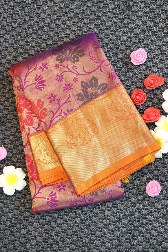 Pink colour kanchipuram silk saree with multi colour floral brocade design