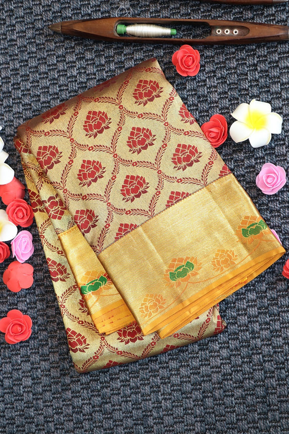 Traditional maroon colour kanchipuram silk saree with yellow colour border and pallu