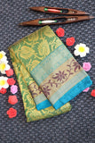 Green colour kanchipuram tissue silk saree with contrast border with silver zari
