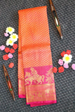 Peach colour kanchipuram silk saree with pink colour border and pallu