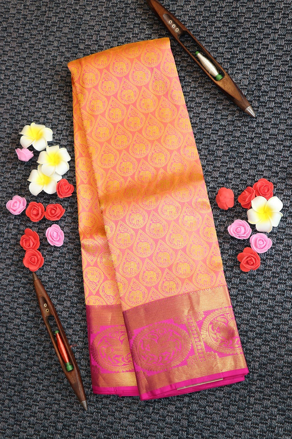 Beige colour kanchipuram silk saree with contrast colour pink border and pallu