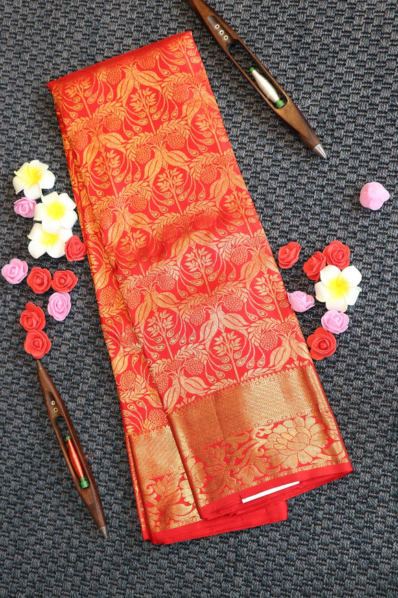 Red colour bridal kanchipuram silk saree with self colour border and pallu