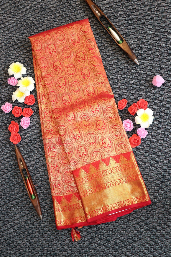 Red colour kanchipuram silk saree with peacock motifs in self colour border and pallu
