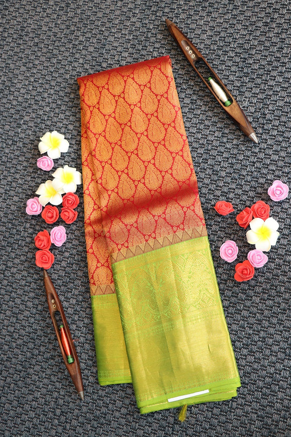 Maroon colour kanchipuram saree with beautiful parrot green border and pallu