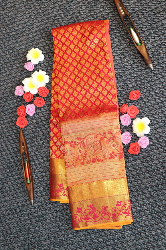 Red colour kanchipuram silk saree with big border with traditional motifs