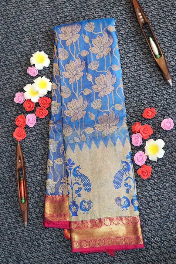Blue colour kanchipuram silk saree with contrast border and pallu with big peacock design on the border