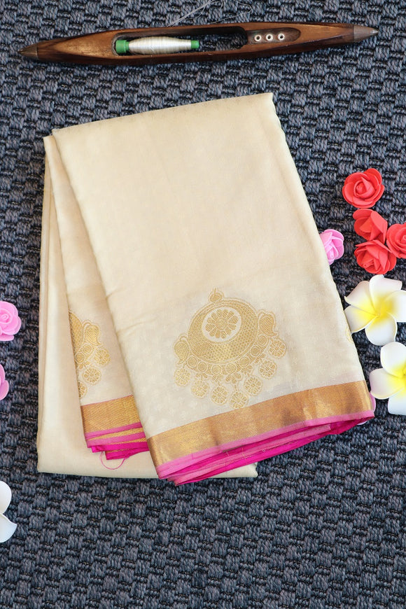 Off white colour kanchipuram saree with silk weaving and zari buttas on the border