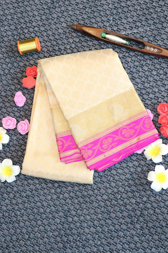 Off white colour silk saree with pink colour border and pallu