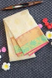 Off white kanchipuram silk saree with baby pink border and pallu