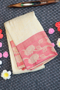 Off white colour kanchipuram silk saree with floral pink border
