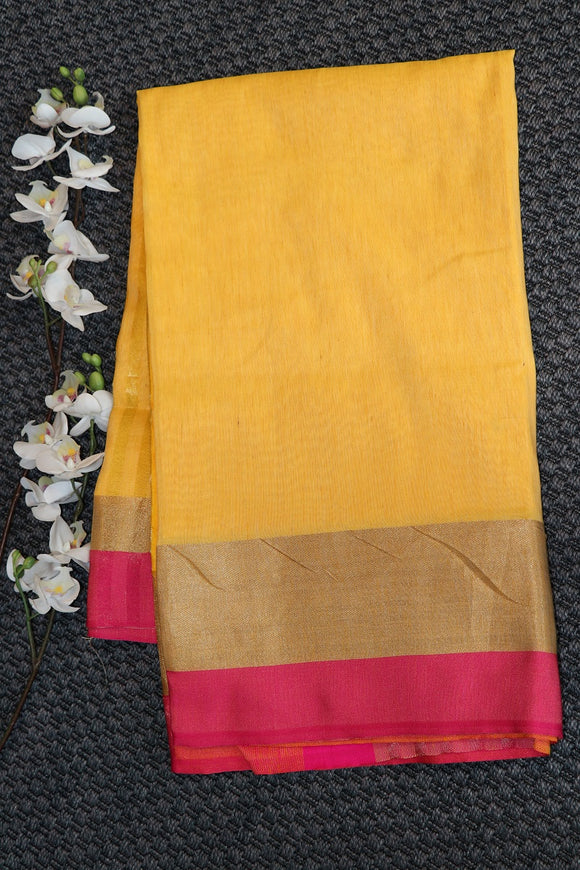 Green colour linen jute plain saree with contrast pallu and border