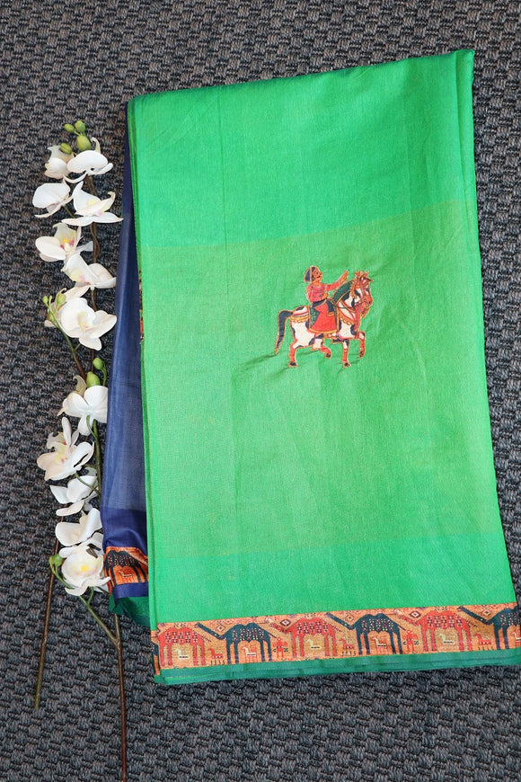 Green colour fancy silk saree with digital printed kalamkari pallu and border