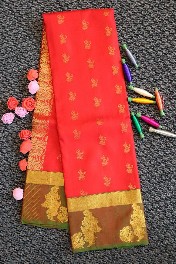 Reddish peach  colour plain pure silk saree with parrot green colour blouse and pallu