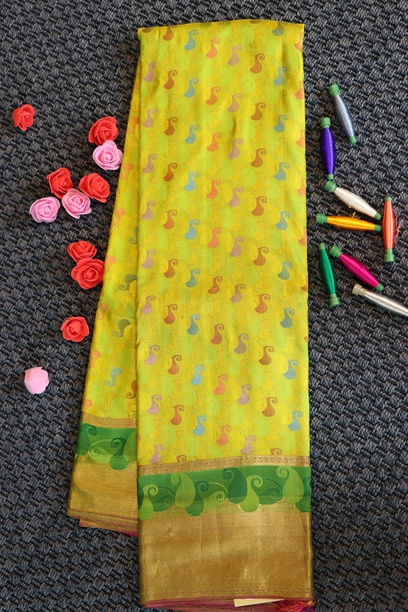 Yellow colour pure silk saree with multi colour mango buttas design
