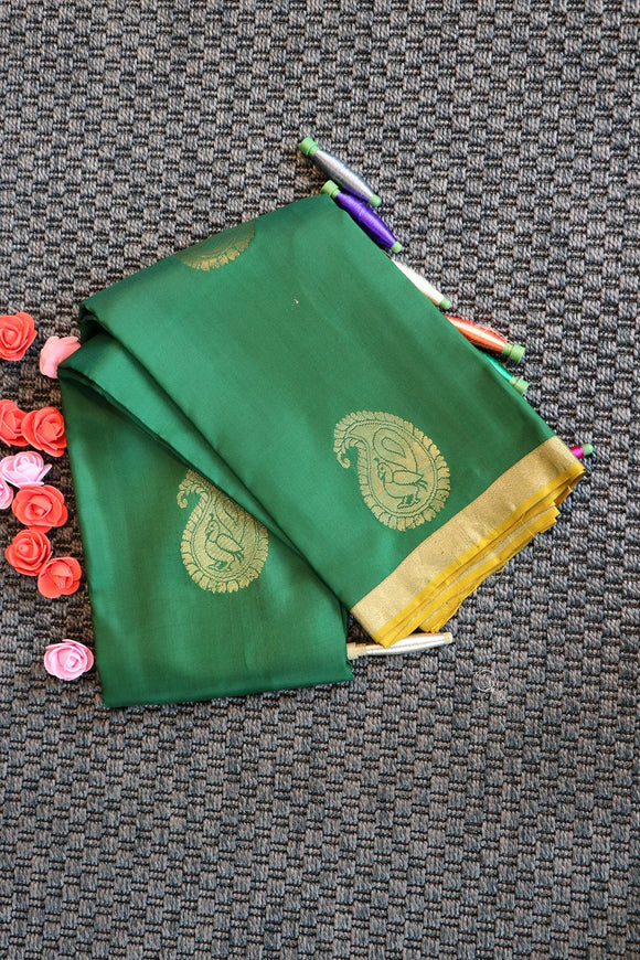 Bottle green pure silk saree with contrast pallu and blouse