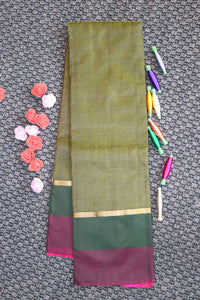 Green colour silk saree with wine colour border and contrast blouse and pallu