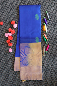 Blue colour pure silk saree with big leaf design above the border in fading style