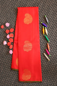 Red colour border less pure silk saree with mango buttas