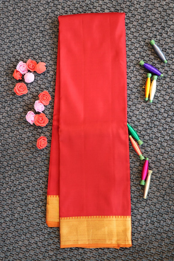 Red colour plain soft silk saree with rich pallu with peacock design