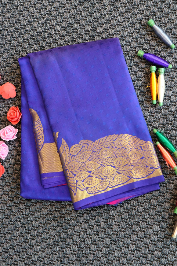 Blue colour pure silk saree with embose design and peacock motifs on the border