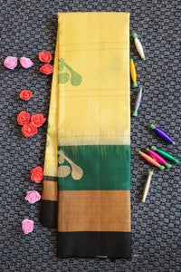Golden beige colour pure silk saree with traditional musical instruments motifs with contrast border and blouse