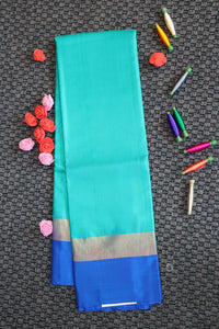 Green colour plain soft silk saree with blue colour border pallu and blouse