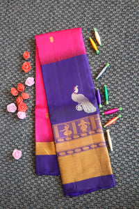 Pink colour soft silk saree with big blue colour border woven with gold and silver zari peacock motifs