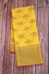 Yellow colour jute linen saree with copper zari weaving