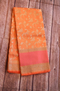 Peachish orange kora silk saree with brocade weaving