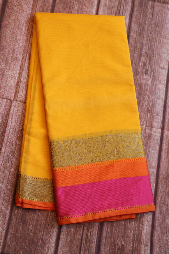 Yellow colour sico saree with pink and orange border with brocade blouse