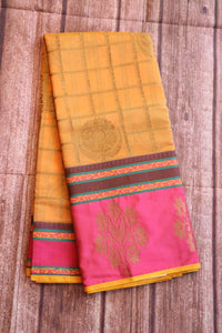 Peach colour jute saree with rich brocade blouse