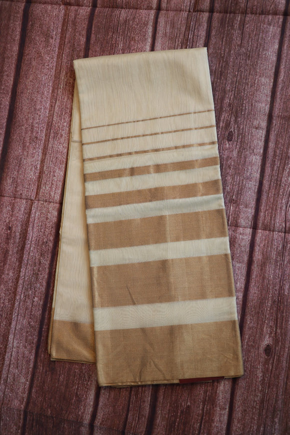 Off white colour plain coimbatore sico saree with big zari border