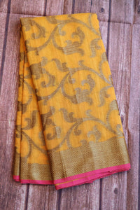 Mustard yellow colour jute saree with antique copper zari weaving