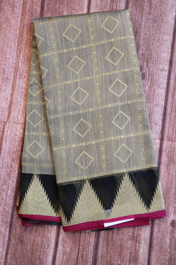 Grey colour bagalpuri jute saree with organza border with temple design