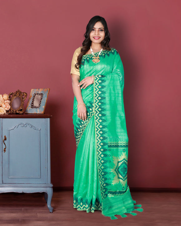 Green colour dupion silk saree with temple border