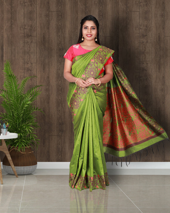 Parrot green saree with floral kalanjali style border