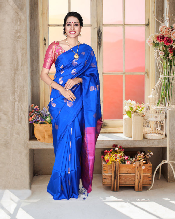 Blue colour borderless soft silk saree with traditional mango buttas