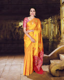 Yellow soft silk saree with peacock motifs and contrast pallu and blouse