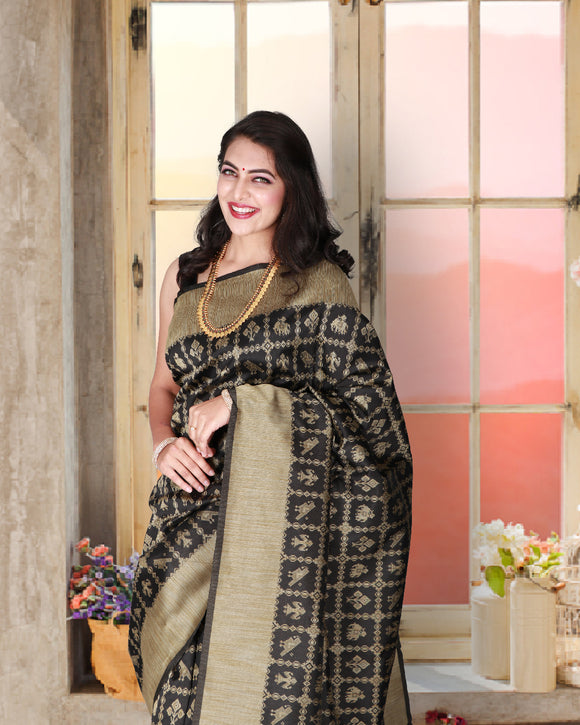 Black soft silk saree with traditional animal motifs in ikkat style