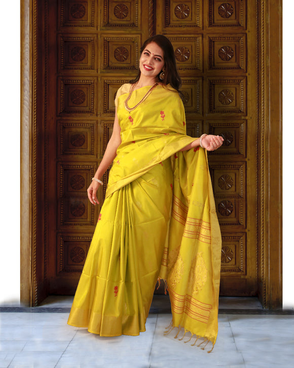 Yellow colour soft silk saree with small floral butta weaving