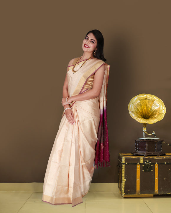 Off white saree with small buttas and contrast pallu and blouse
