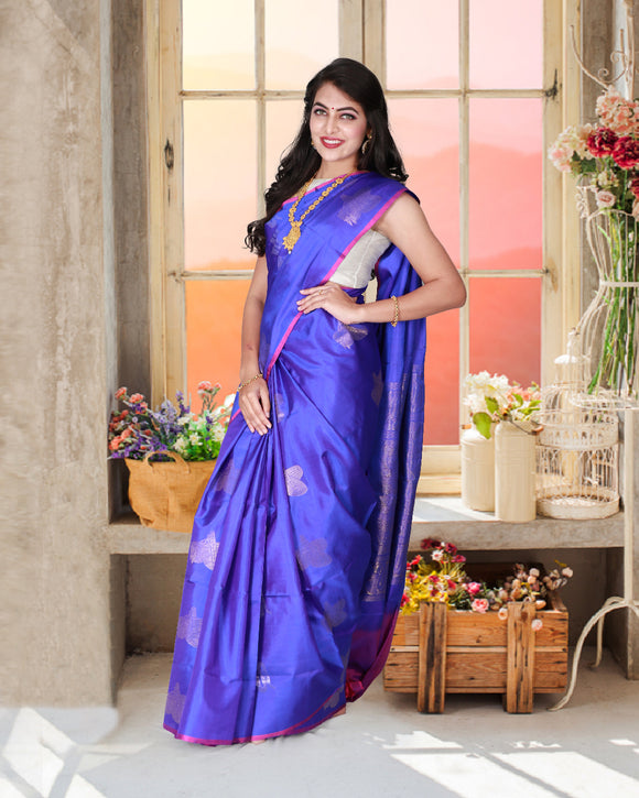 Blue soft silk saree with traditional musical instruments design