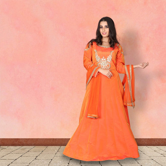 Orange colour silk suit with work on the yoke