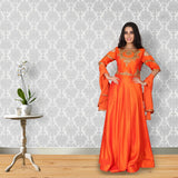 Orange colour silk suit with embroidery work on the yoke