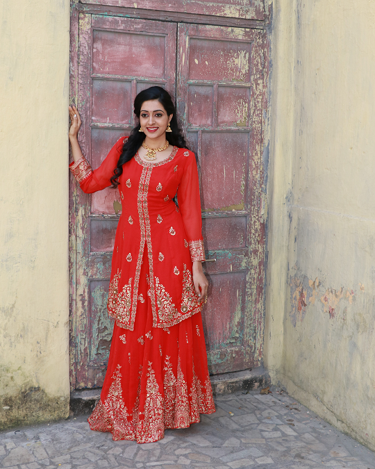Red colour hand embroidered croptop lehenga with long blouse
