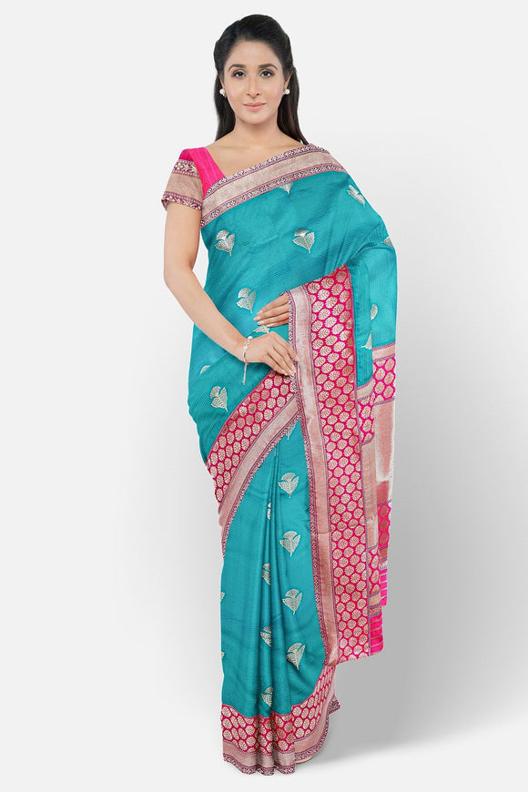 Green colour banaras saree with pink border