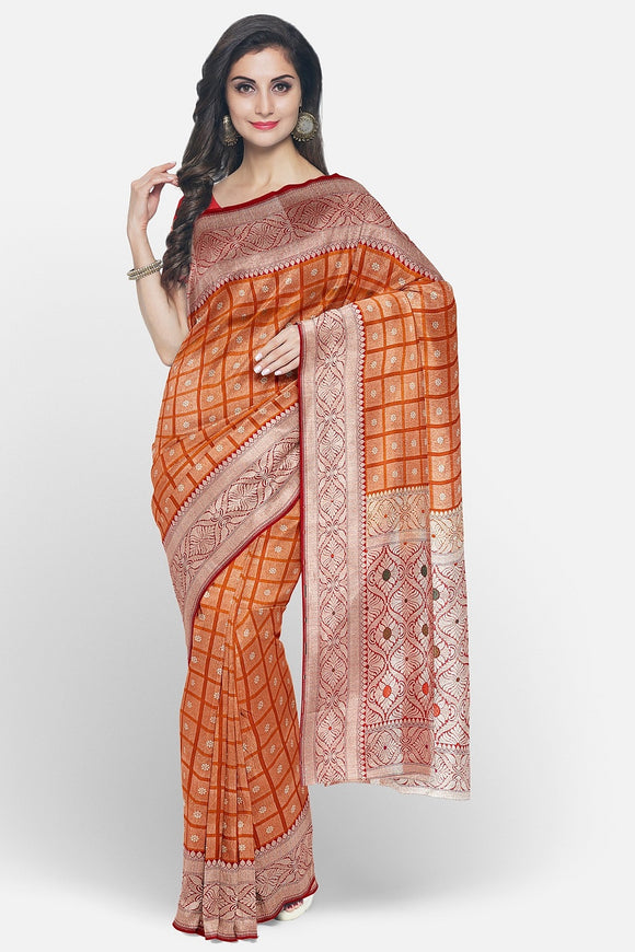 Orange colour silk saree with zari weaving