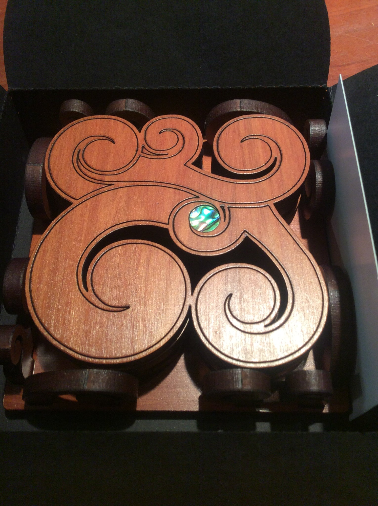 Paua Koru coasters in Caddy
